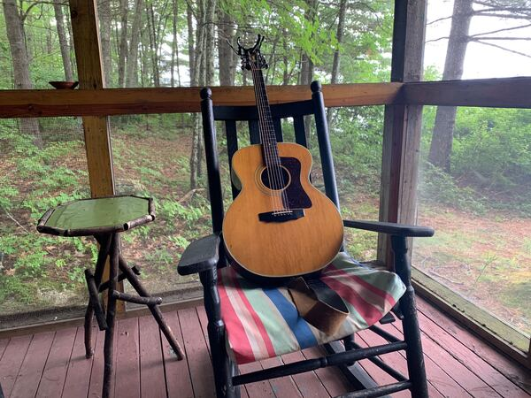 Jim039s guitar on rocking chair on porch