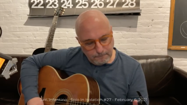 Jim Playing music from his sofa