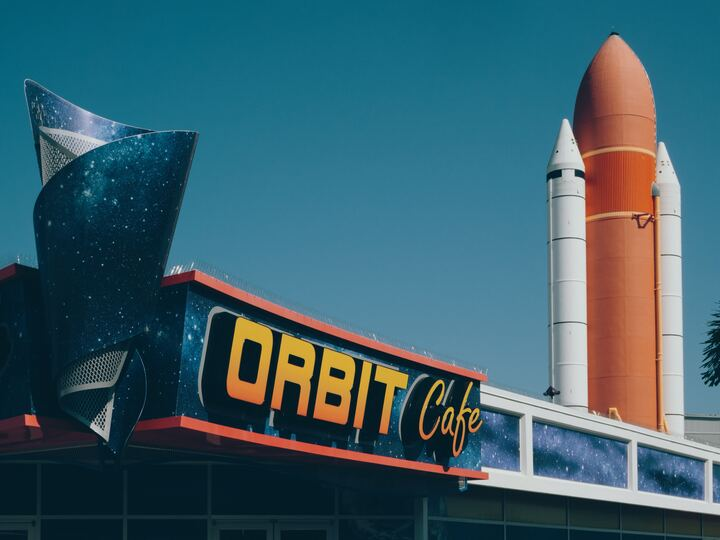 image of cafe with space shuttle parts behind